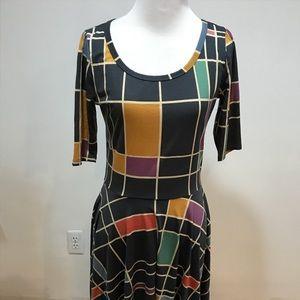 Size M. Lularoe Nicole dress. Looks new!